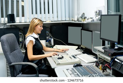 TV director (young woman) at editor in studio
