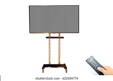 TV flat screen stand with noise and hand hold remote control or Present mock up blank screen isolated or Black error led monitor mockup or Flatscreen retro broadcasting of  background monochrome