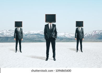 TV headed businesspeople standing on abstract landscape background. Brainwash and manipulation concept