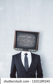 TV headed man standing on concrete wall background. Brainwash and control concept