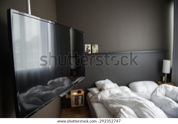 TV in a hotel room, colour photo.