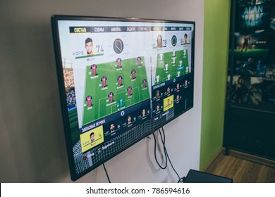 TV with the image of the game on FIFA Russian version on the Microsoft Xbox, a video game console.