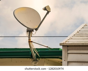 TV and Internet satellite dish installed on the roof.