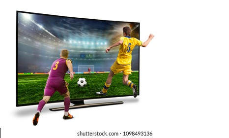 TV. A monitor broadcasting a football match from the stadium. Isolated. Two players are fighting for the ball. Dangerous situation. The concept. World Championship