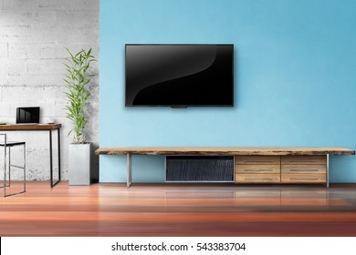 Tv on light blue wall with wooden table and plant in pot empty living room interrior