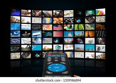 TV with pictures of smart television and remote control,close up.