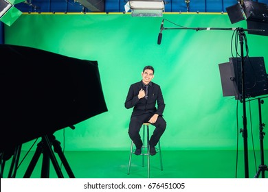 TV presenter preparing to live streaming video , Business professional work , Behind the scenes of TV movie video film