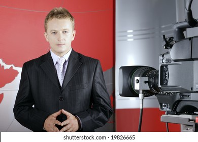 tv presenter in studio in front of the camera and viewers