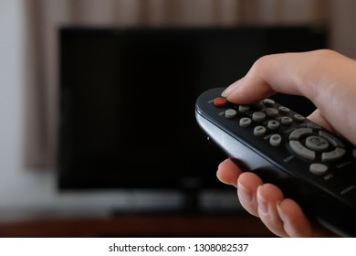 TV remote control in hand