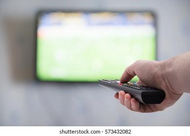 TV remote control in hand