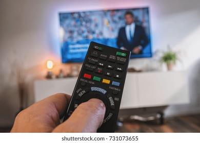 TV remote control, the hand with a remote control, pov view