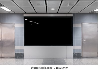 TV screen on wall for advertising. Background of city street / subway train station blank billboard for advertisement.