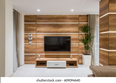 Tv set on wooden waal in living room interior