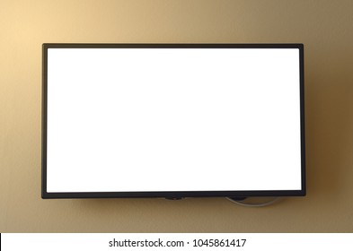 TV set with white blank screen mounted on yellow wall. TV template with copy space.