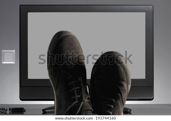 TV and shoes out of focus with neutral background. Horizontal
