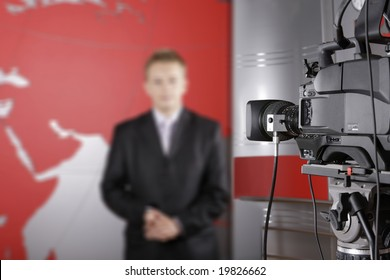TV studio with video camera and unrecognizable presenter