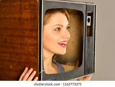 tv transmission. funny tv transmission for happy woman. tv transmission for woman hold retro television set. tv transmission concept. funny movie