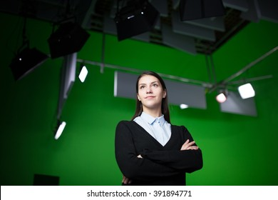 TV weather news reporter at work.News anchor presenting the world weather report.Television presenter recording in a green screen chroma key studio.Journalist presenting report.TV behind the scenes