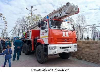 TVER, RUSSIA - APRILL, 30, 2016: Kamaz fire trucks with ladders at the Day of a Firefighter in the city park