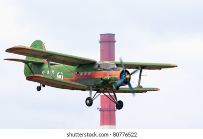 TVER, RUSSIA - JULY 09: Antonov An-2 multipurpose biplane flies during the Tver Blue Skies aviation festival on July 09, 2011 in Tver, Russia