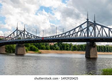 Tver Russia June 2017. Automobile iron bridge over the Volga River on the background of a sandy beach
