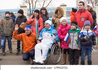 TVER, RUSSIA - MARCH 2, 2014: People take photographs of the torchbearer in a wheelchair. In the Paralympic Torch Relay in Tver involved 100 torchbearers