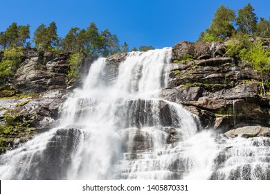 Tvidefossen waterfall in spring. Voss, Norway.