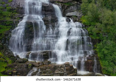 Tvindefossen (also written Tvinnefossen; also called Trollafossen) is a waterfall near Voss, Norway. It is 12 km from Voss on the road to Flam(Flom).