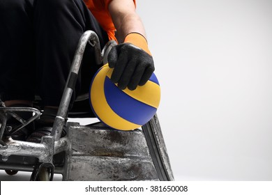 TVolleyball.he man on the sports wheelchair with the ball