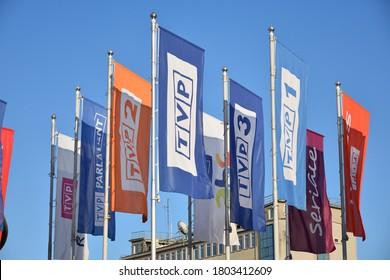 TVP flags (TVP1, TVP2, TVP3) near Polish television (Telewizja Polska) office. WARSAW, POLAND - AUGUST 10, 2020
