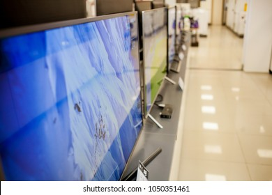 TVs in the supermarket. eletronic department store show Television TV and home applianc.