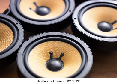 Tweaking audio. Audio speakers on a work table. Shallow depth of field.