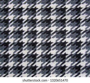 Tweed fabric houndstooth texture, wool pattern close up, woven textile background