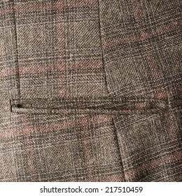 Tweed striped jacket cloth material fragment with the pocket as a background texture composition