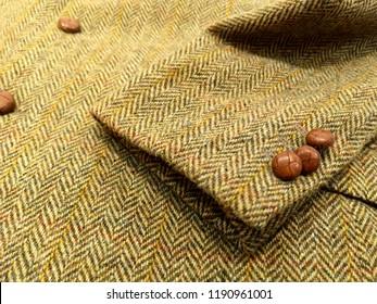 Tweed wool jacket. yellow background