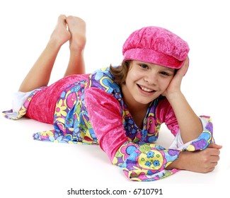 Tween flower-child laying on the floor with her head propped up by her bent arm.