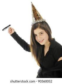 A tween girl dressed in black celebrating the New Year with a noise maker and silver party hat.  On a white background.