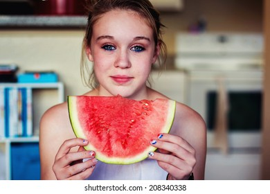 Tween girl eating a watermelon -- image taken in Reno, Nevada, USA
