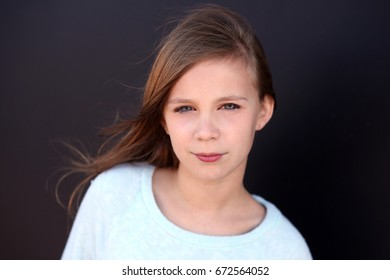 tween girl with hair blowing
