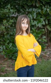 Tween Girl in Yellow with serious attitude