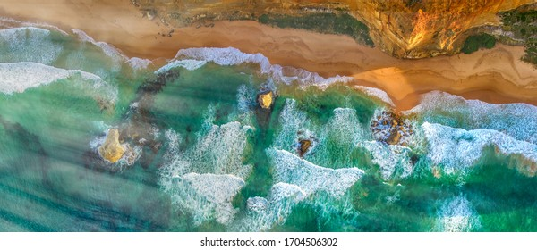 The Twelve Apostles along Great Ocean Road in Victoria, Australia. Port Campbell National Park on a beautiful sunrise, aerial view.