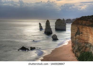 Twelve Apostles in Australia at Great ocean road at cloudy sunset