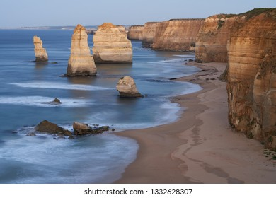 The Twelve Apostles as the first rays of the morning sun hit them on the Great Ocean Road, Victoria, Australia.