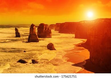 Twelve Apostles, natural landmark near the Great Ocean Road at dramatic sunset. Victoria, Australia