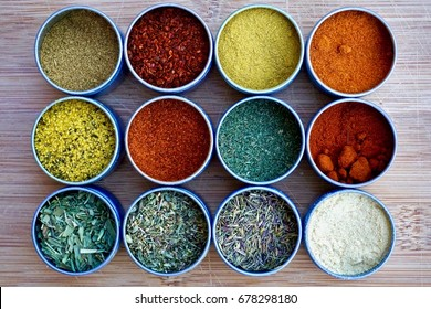 Twelve assorted dried spices and herbs for cooking