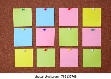 Twelve color sticky free space notes card on cork board.