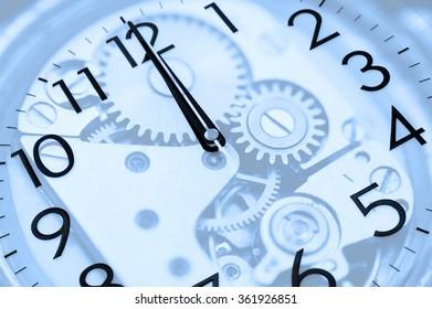 twelve oclock (midnight or midday) on clock, double exposure, blue toning