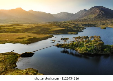 Twelve Pines Island, standing on a gorgeous background formed by the sharp peaks of a mountain range called Twelve Pins or Twelve Bens, Connemara, County Galway, Ireland