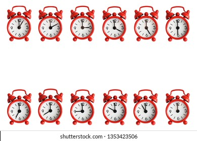 Twelve red metal alarm clocks isolated on a white background. Clocks are showing every hour of the day. Copy space