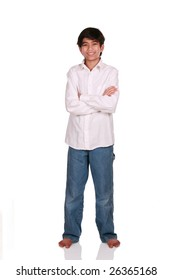 Twelve year old boy standing arms crossed, part Asian - Scandinavian background